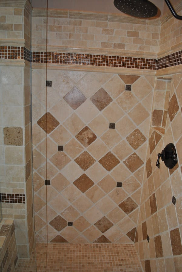 Detail of the bottom of a tile shower by RNB Flooring